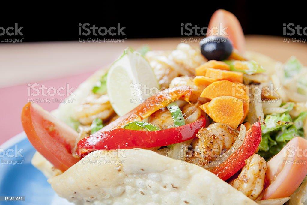 Mexican food: shrimp fajita salad in a crisp chalupa shell royalty-free stock photo