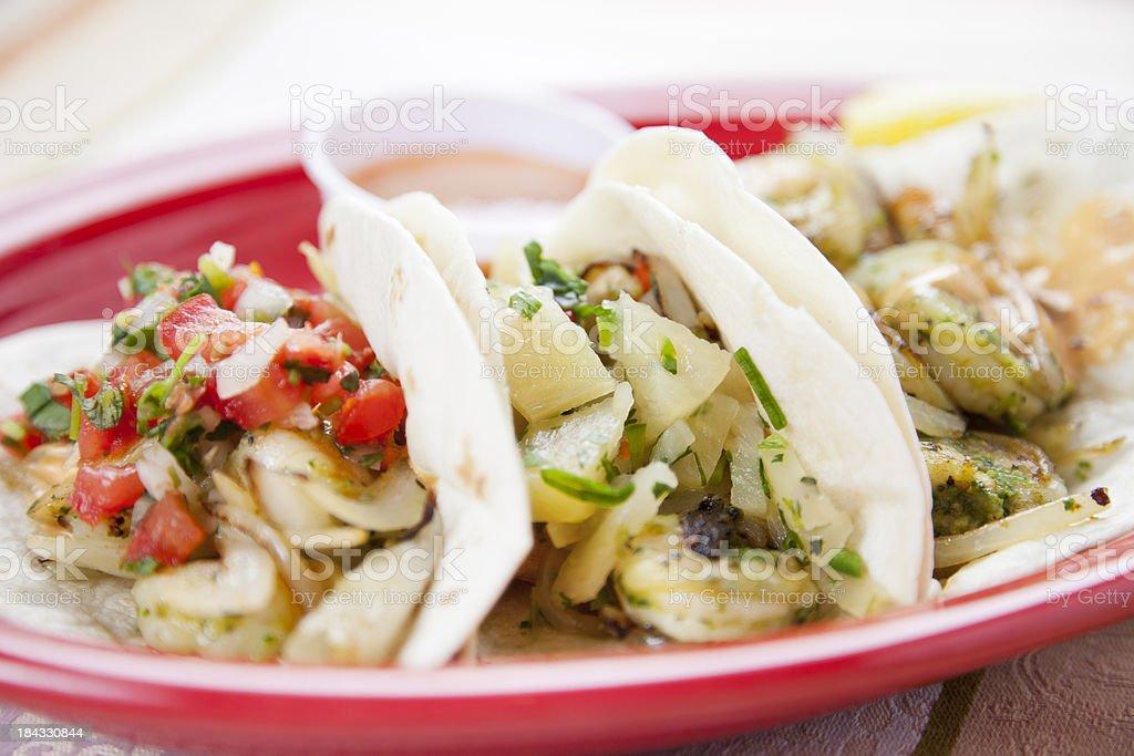 Mexican food: three gourmet shrimp tacos stock photo