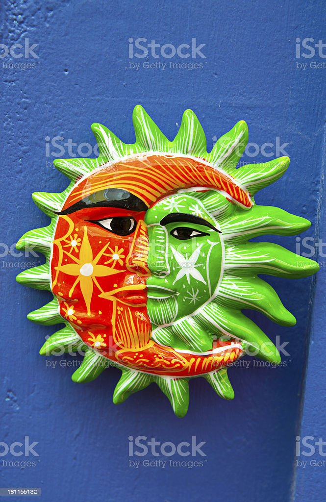 Mexican Gift Shop with Painted Terracotta Sun and Moon royalty-free stock photo