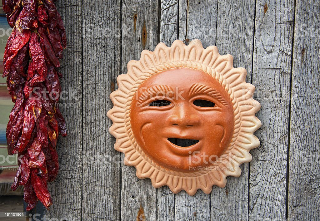 Mexican Gift Shop with Terracotta Sun on Display royalty-free stock photo