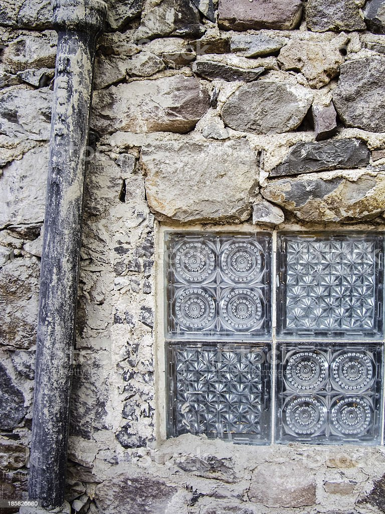 Mexican Glass window and Drainpipe royalty-free stock photo