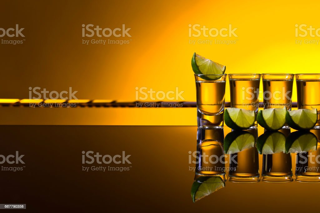 Mexican Gold Tequila in short glasses with lime stock photo