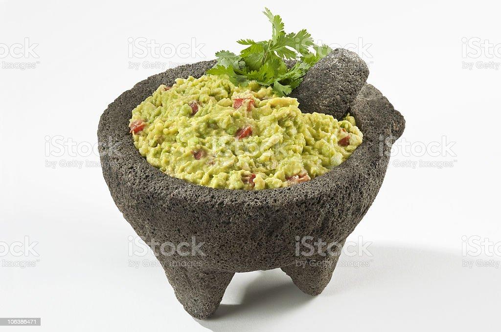 Mexican Guacamole in Molcajete stock photo