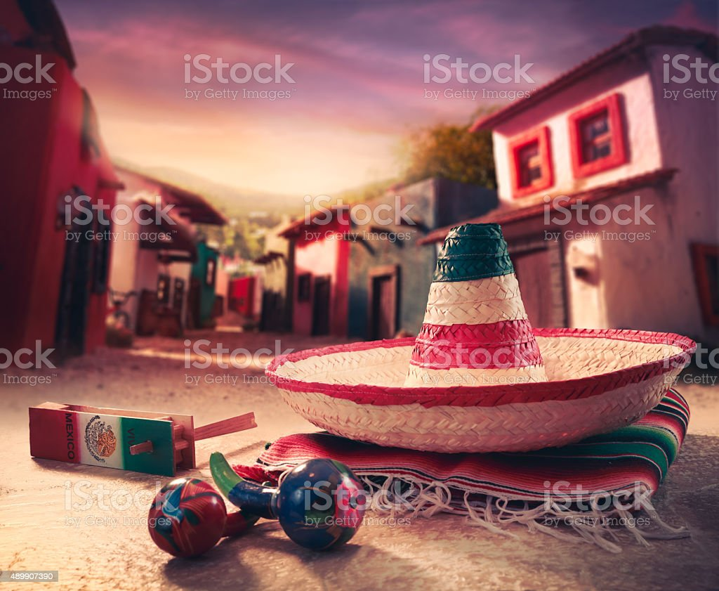 Mexican hat, or 'sombrero' and rattles on a 'serape' stock photo