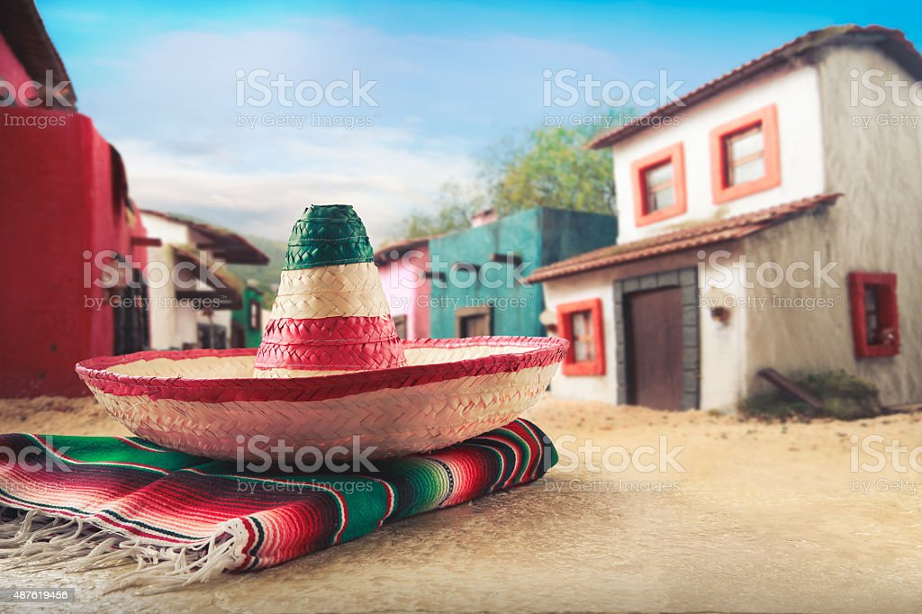 Mexican hat 'sombrero' on a 'serape' at village stock photo