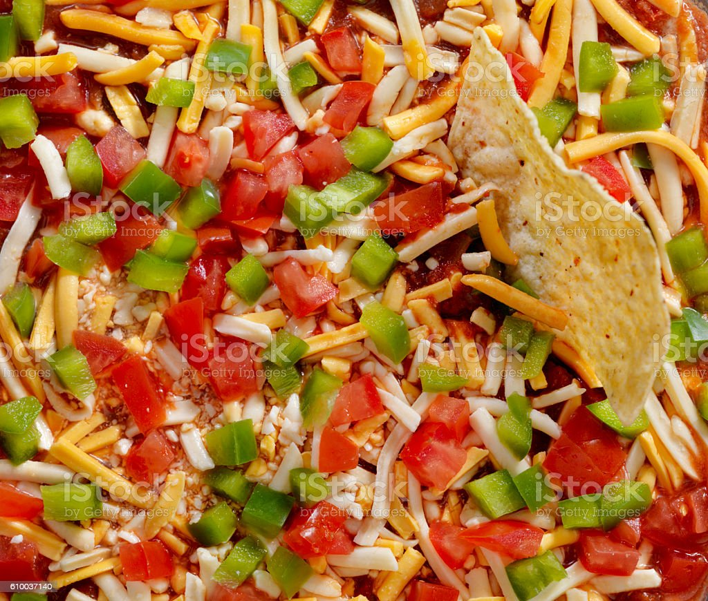 Mexican Layer Dip with Tortilla Chips stock photo