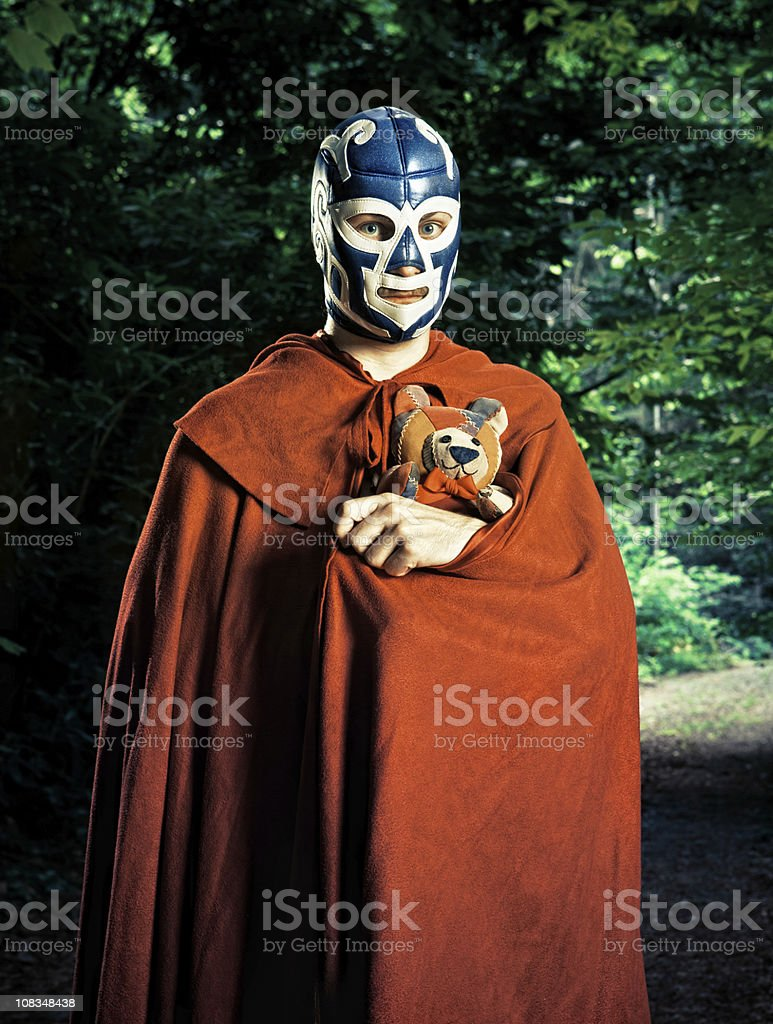mexican lucha libre fighter with stuffed toy stock photo