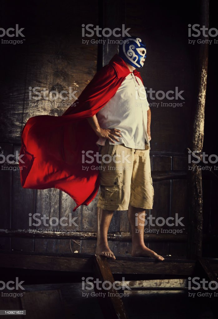 mexican luchador standing in front of a beach cabana stock photo