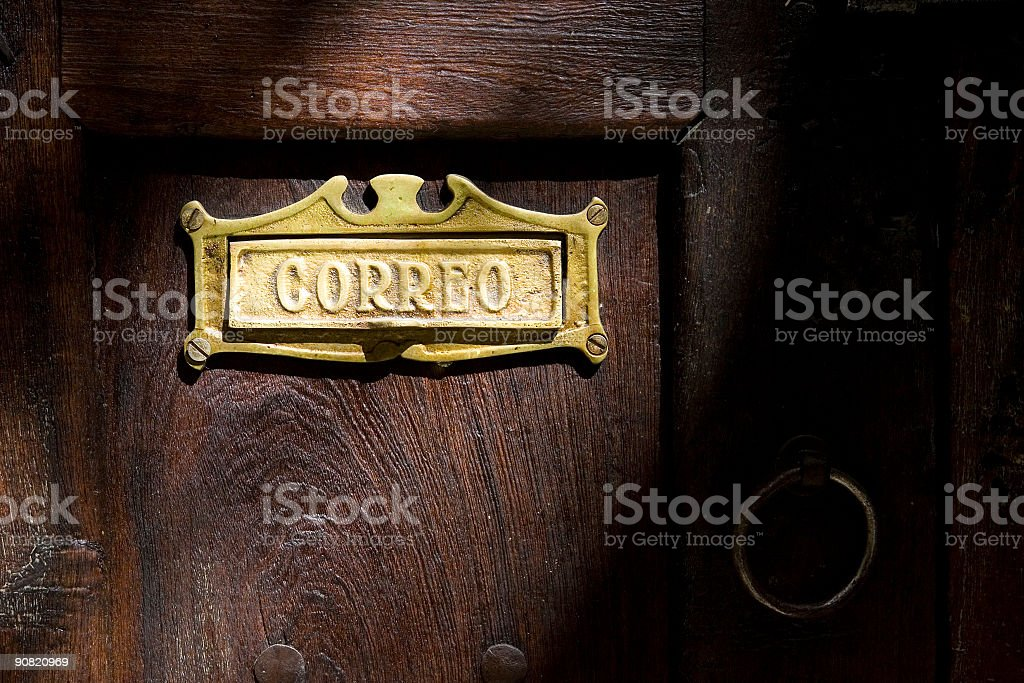 Mexican Mail Delivery Slot on Dark Wood Door royalty-free stock photo