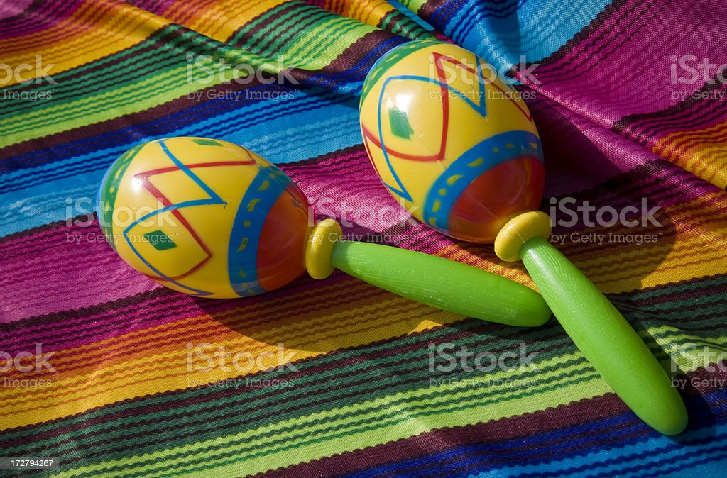 Mexican Maracas on Colorful Poncho Background stock photo