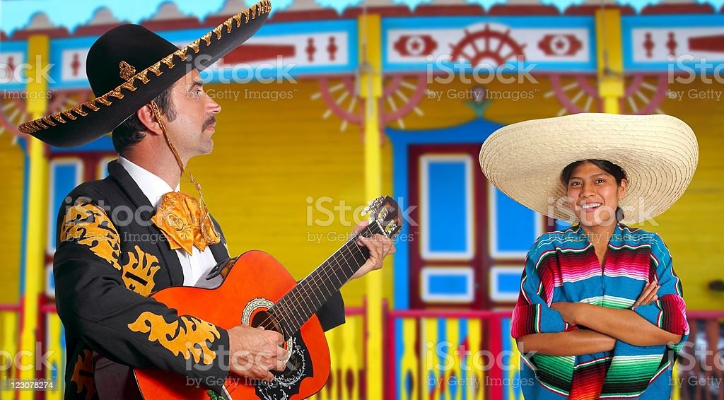 Mexican mariachi charro man and poncho Mexico girl royalty-free stock photo