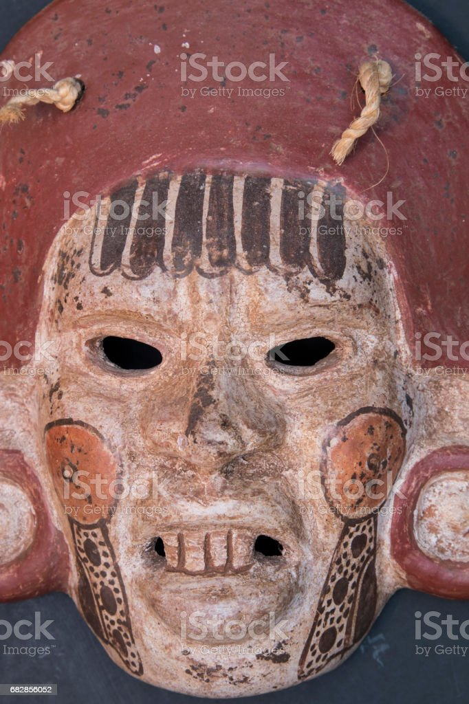 Mexican Mayan Aztec wood and ceramic mask, scary face stock photo
