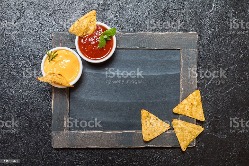 Mexican nacho with sauces and chalk board stock photo