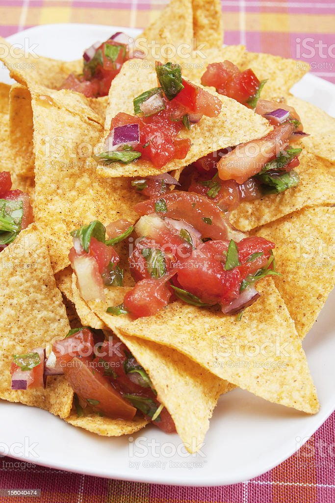 Mexican nachos corn chips with salsa royalty-free stock photo