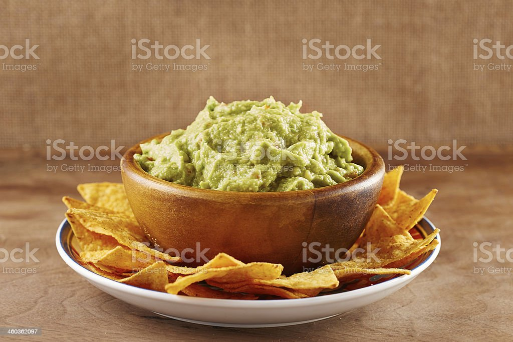 Mexican nachos with handmade guacamole sauce stock photo