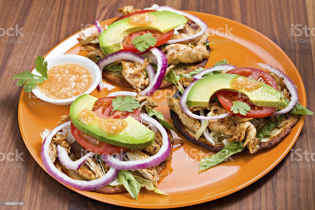 Mexican Panuchos On An Orange Plate royalty-free stock photo