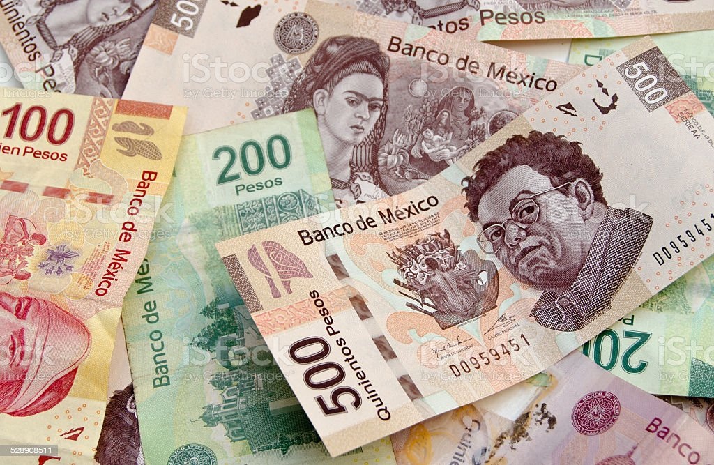 Mexican Peso bank notes background stock photo