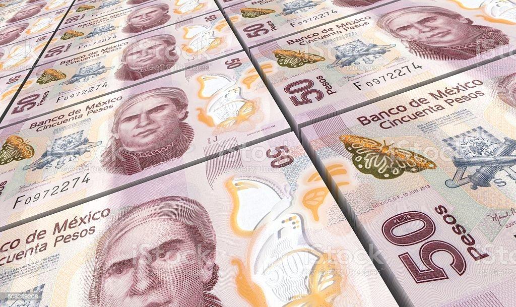 Mexican pesos bills stacks background. stock photo