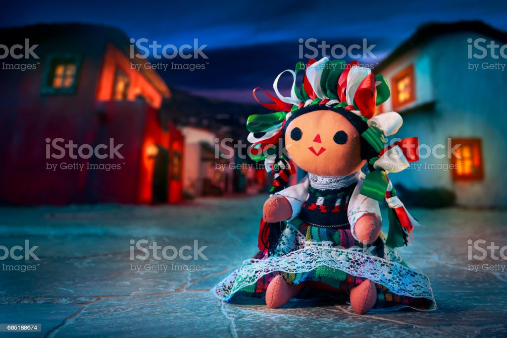 Mexican rag doll in a traditional dress at night stock photo