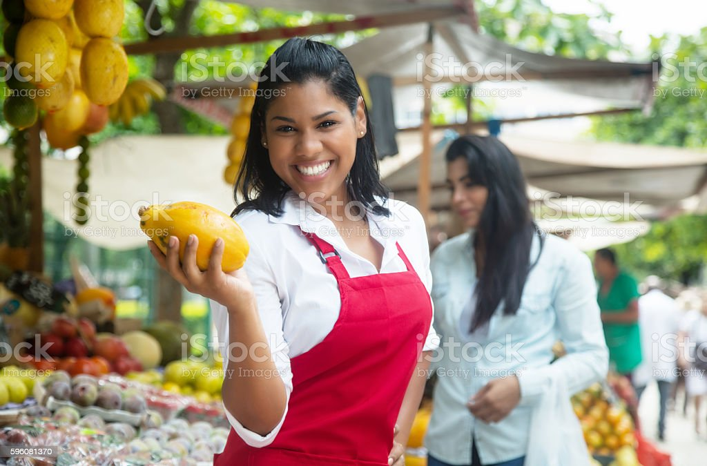 Mexican saleswoman on a farmers market selling fresh fruits stock photo