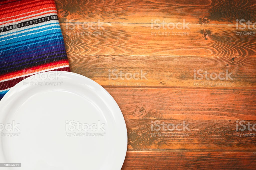 Mexican Serape and White Plate stock photo