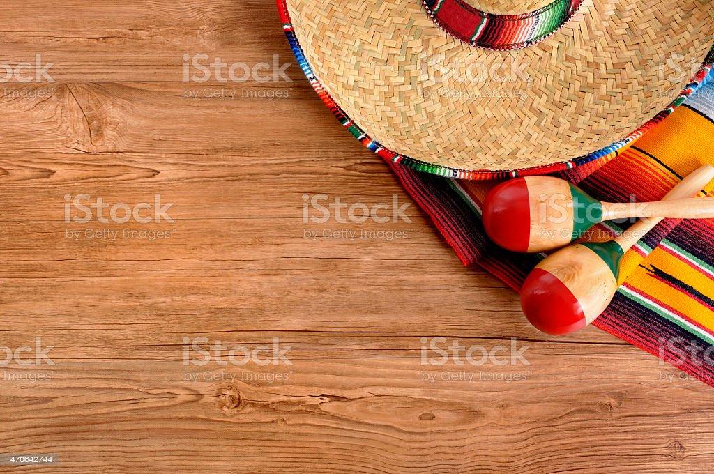 Mexican sombrero and blanket on pine wood floor stock photo
