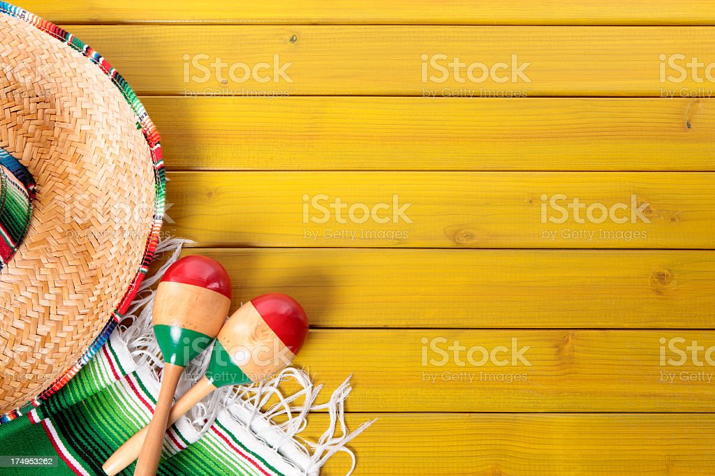 Mexican sombrero and maracas on a picnic table royalty-free stock photo