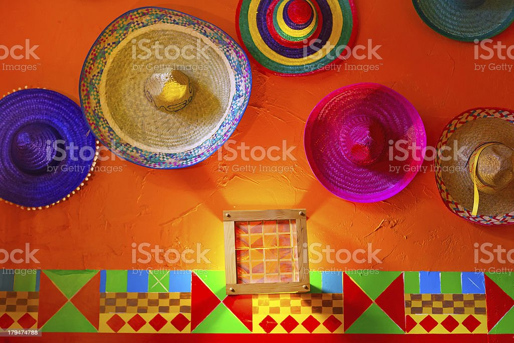Mexican sombreros on the wall stock photo