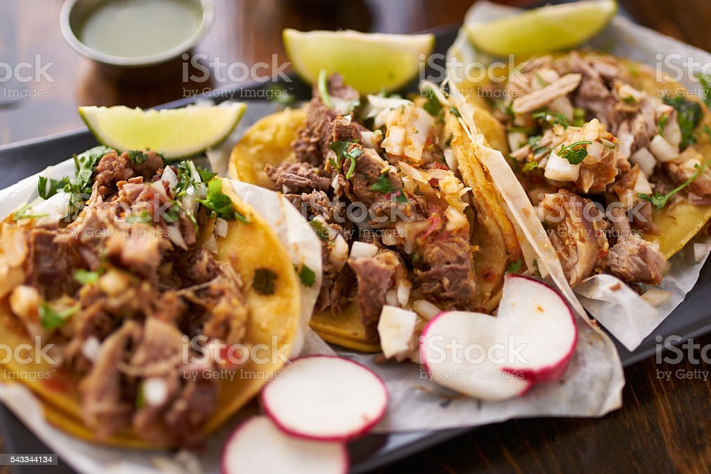 mexican street tacos with chicken, carnitas and barbacoa stock photo