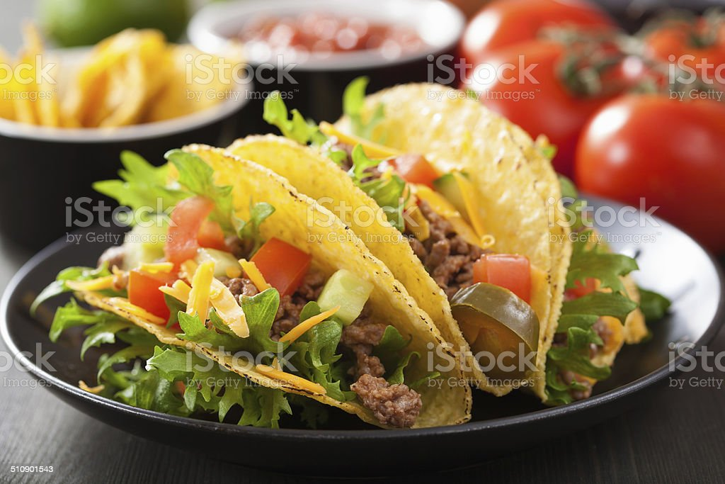 mexican taco shells with beef and vegetables stock photo