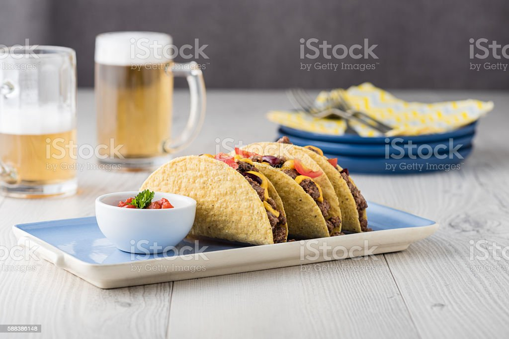 Mexican tacos with beef, cheddar cheese, tomato stock photo