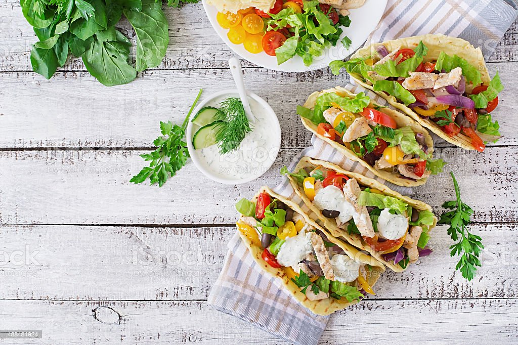 Mexican tacos with chicken, bell peppers, black beans stock photo