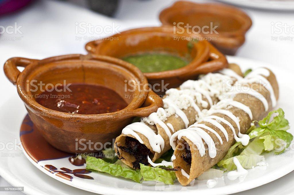 Mexican Taquitos (flautas) stock photo