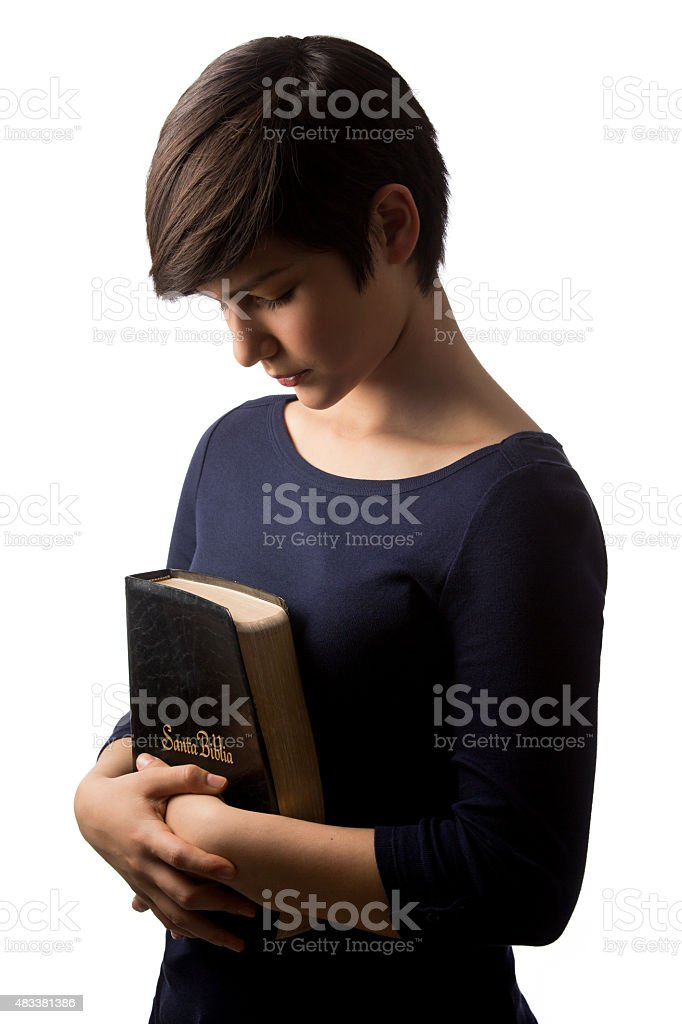 Mexican teenage girl holding a bible stock photo