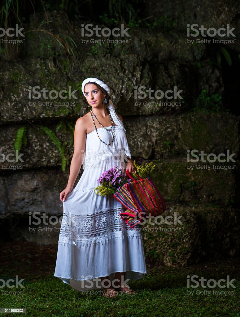 Mexican teenager with traditional clothes and flowers stock photo