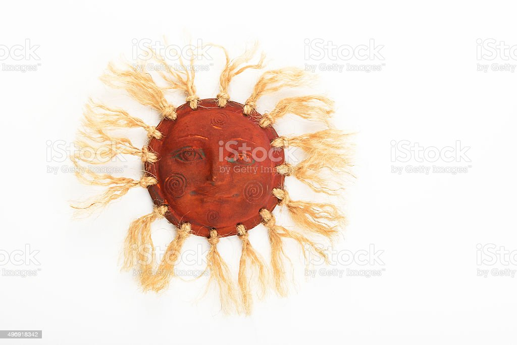 Mexican traditional ceramic happy sun symbol plate isolated on w royalty-free stock photo