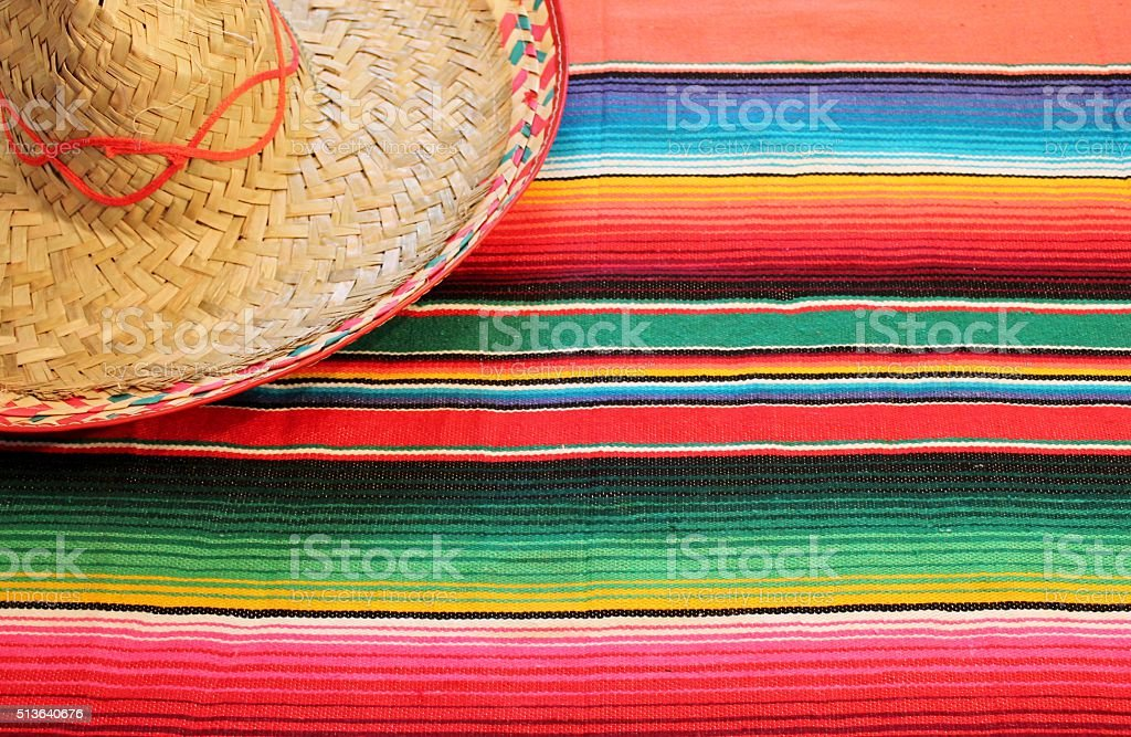 mexican traditional cinco de mayo rug poncho fiesta with stripes stock photo