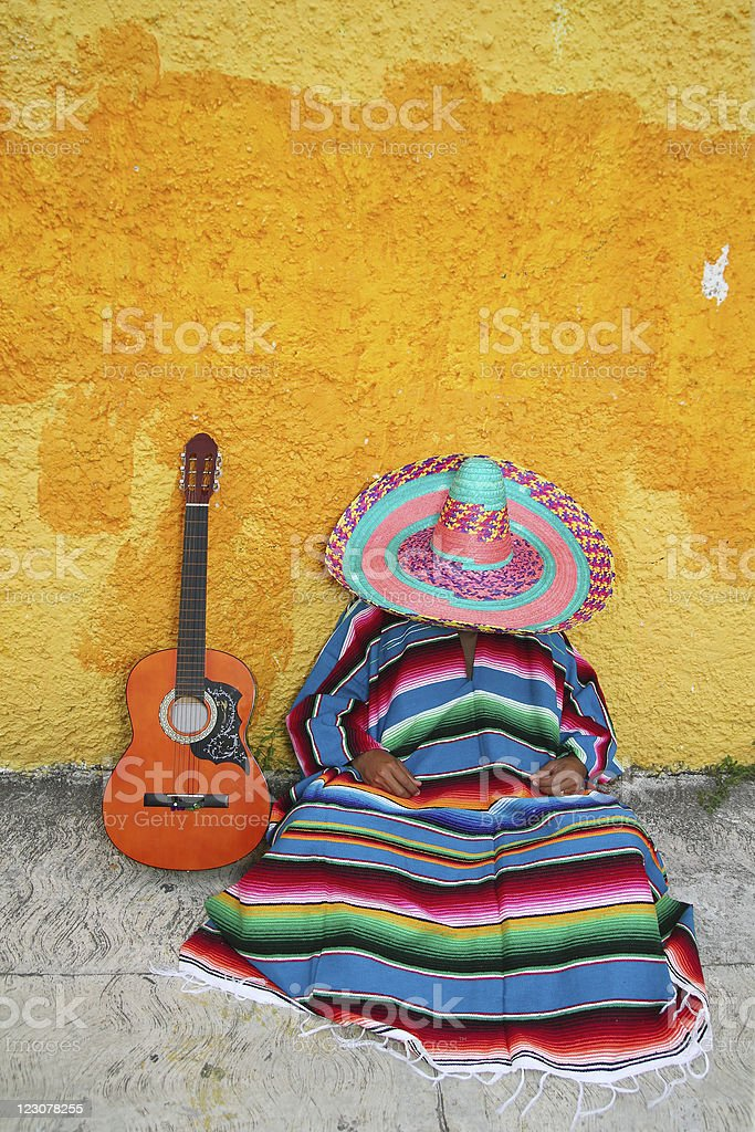 Mexican typical lazy man sombrero hat guitar serape stock photo