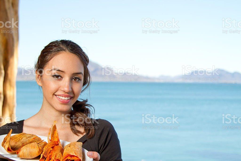 Mexican Waitress serving Tamalies royalty-free stock photo