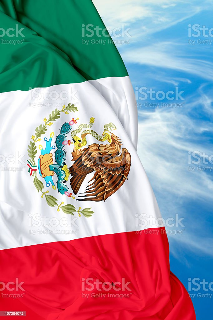 Mexican waving flag on beautiful day stock photo