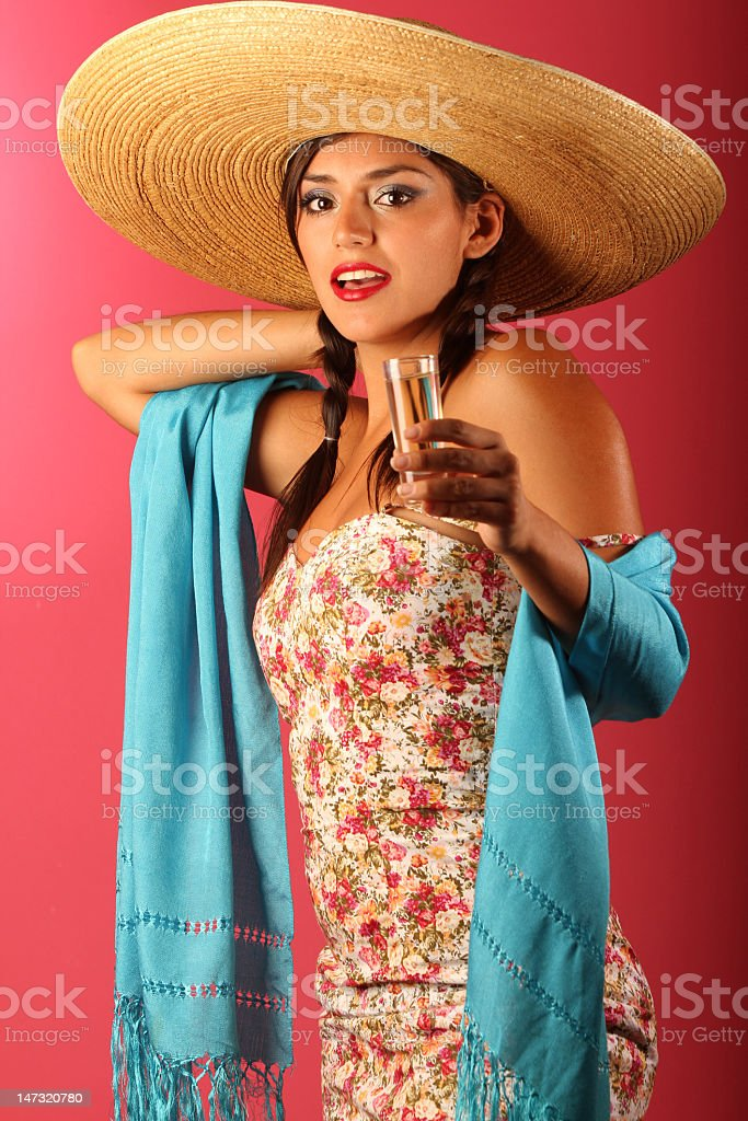 Mexican woman drink a tequila shot. stock photo
