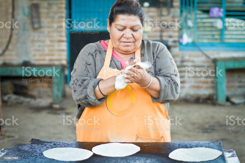 Mexican Woman Making Tortillas stock photo