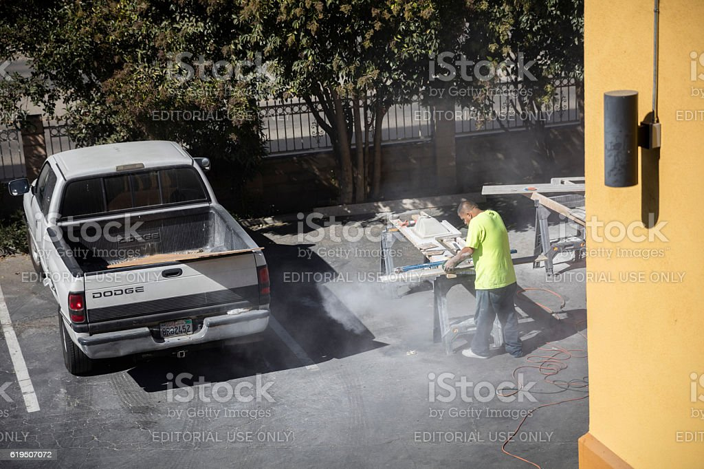 Mexican Worker Cutting Granite Without Any Protection stock photo