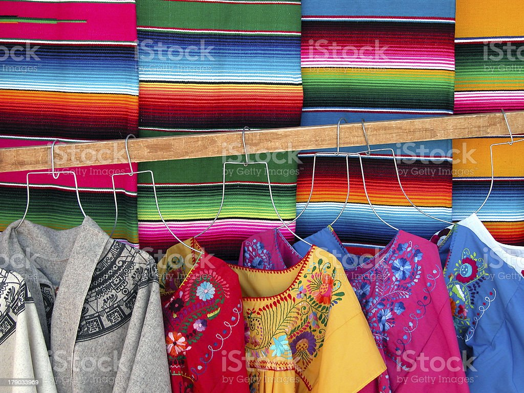 Mexican woven sarapes and dresses stock photo