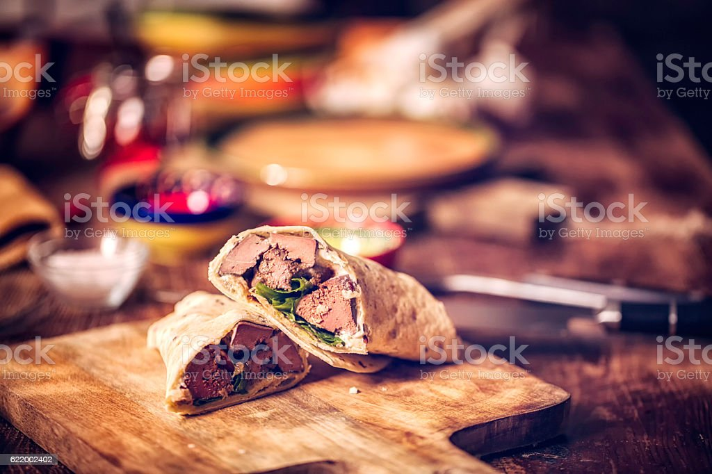 Mexican Wraps with Spicy Beef and Sour Cream stock photo