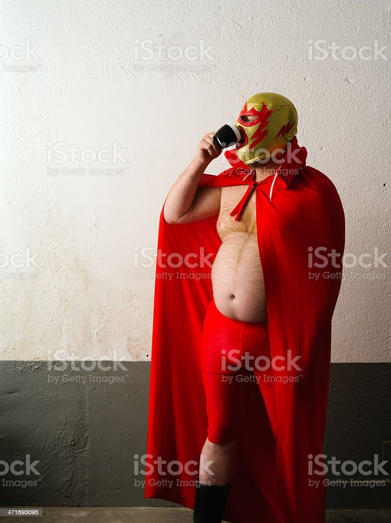 Mexican wrestler drinking coffee stock photo