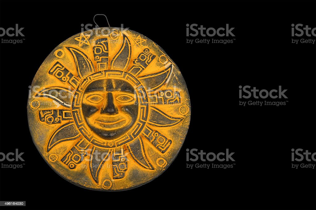 Mexican yellow ceramic sun souvenir isolated on black royalty-free stock photo