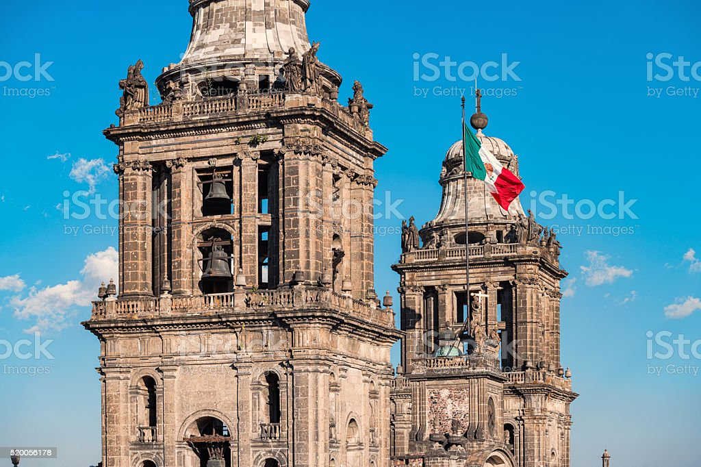Mexico City Metropolitan Cathedral with Mexican Flag stock photo