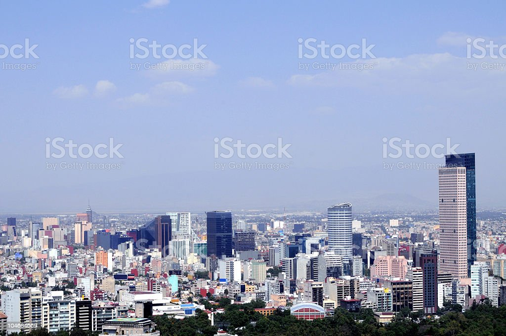 A Mexico City skyline with tall buildings on the horizon stock photo