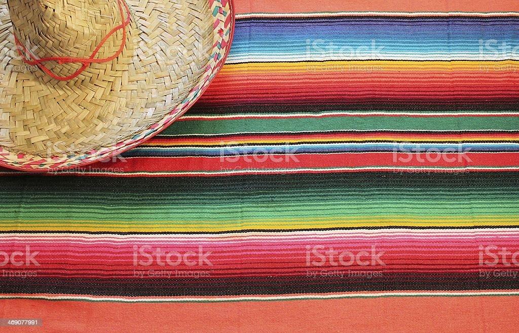Mexico fiesta poncho serape rug blanket sombrero background copy-space stock photo